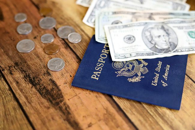 American passport and US dollars and coins